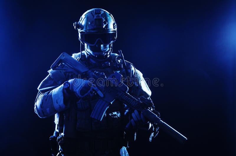 Special forces soldier. With rifle on dark background royalty free stock image