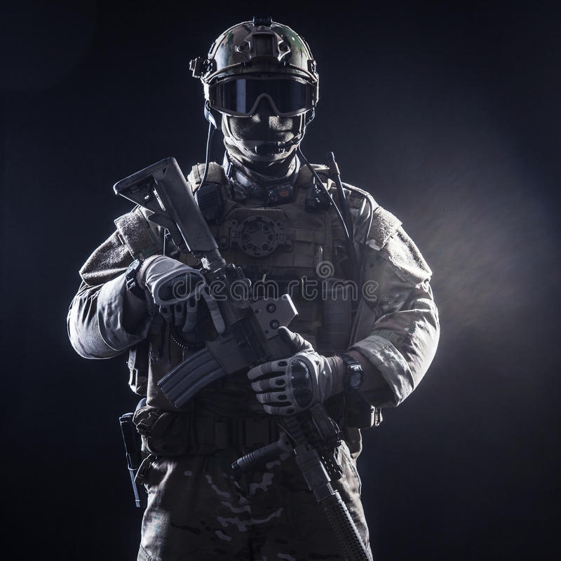 Special forces soldier. With rifle on dark background stock image
