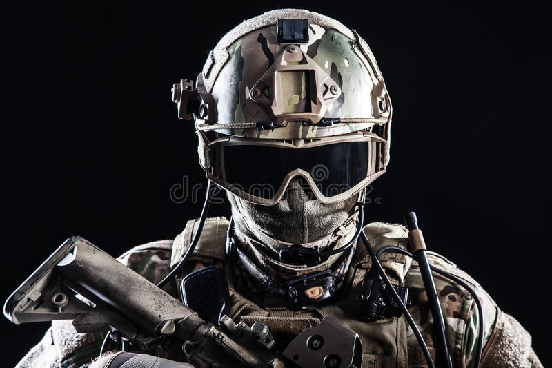 Special forces soldier. With rifle on dark background stock photos