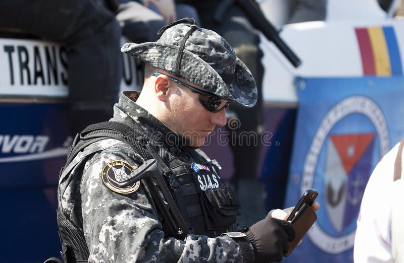 Special forces soldier. Romanian special forces soldier speaking in phone