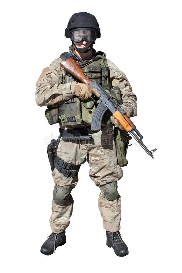 Special Forces soldier, s favorite weapon of terrorists, AK-47, isolated on white royalty free stock image