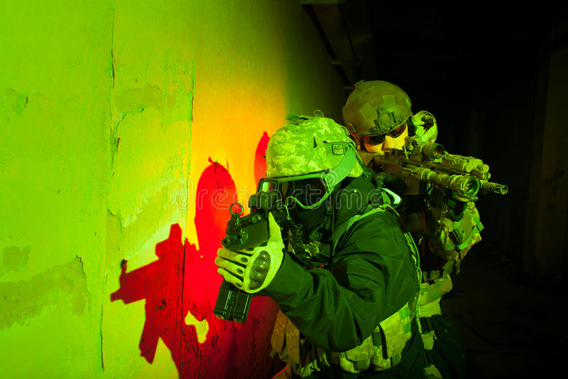 Special forces soldier team during night mission. Special forces soldier/Anti-terrorist unit policeman/ private military/security contractor team during night royalty free stock photography
