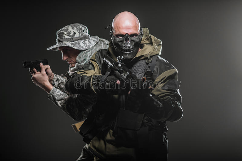 Special forces soldiers men with Machine gun on a dark background stock photography