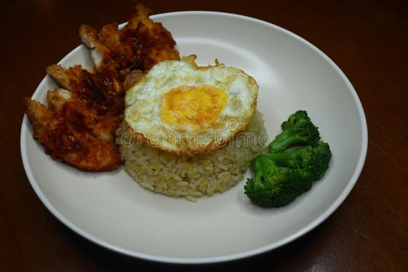 Special fried rice with spicy chili fried chicken sauce, broccoli and fried omelet stock photos
