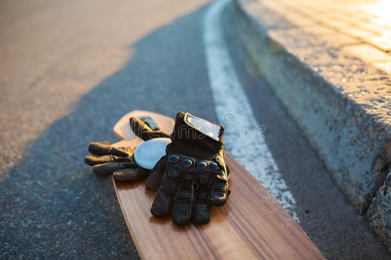 Special gloves for longboard riding on longboard. Riding kit.  royalty free stock photos