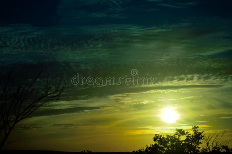 A sunset to enchant our eyes. A special image I saw while traveling. The sun saying goodbye royalty free stock photography
