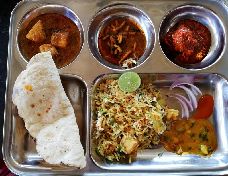 Special Indian Veg Thali dish. Indian special thali dish served with roti, spicy cooked vegetables, rice and garnishing stock photos