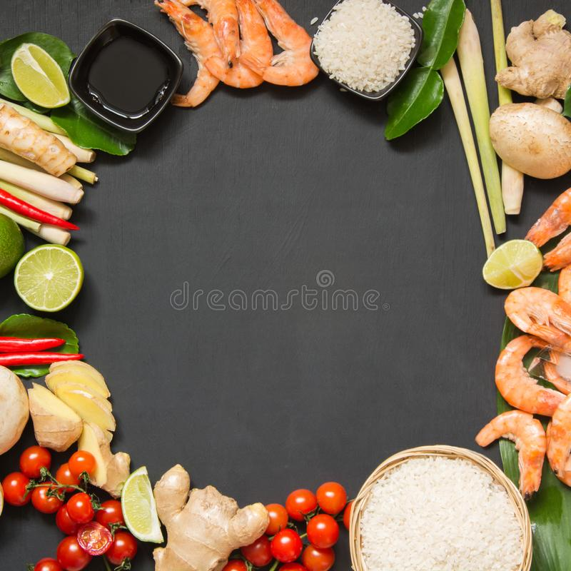 Special ingredients for popular Thai spicy soup Tom-yum kung lime, galangal, red chili, cherry tomato, lemongrass and kaffir lime stock image
