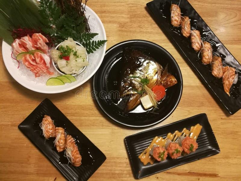 Special Japanese meal, variety of sushi, Salmon head, Salmon sushi, Salmon sashimi royalty free stock photo