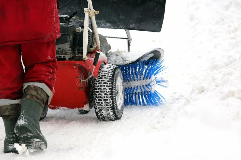 Special machine for snow removal cleans the road stock photo