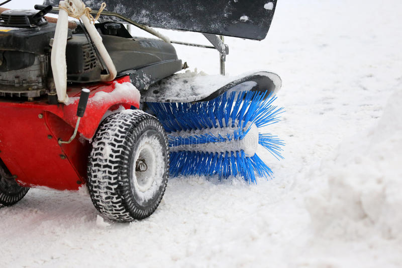 Special machine for snow removal cleans the road. The special machine for snow removal cleans the road royalty free stock photos