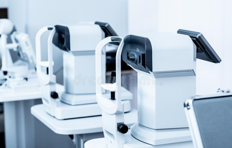 Special modern ophthalmologic clinic white diagnostics devices royalty free stock photography