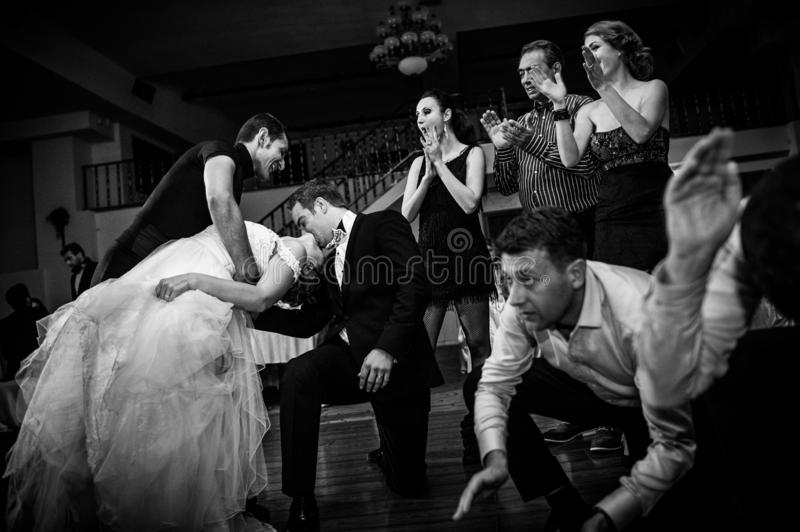 Wedding party dance. Special moment. Bride and groom dancing and kissing at their wedding party