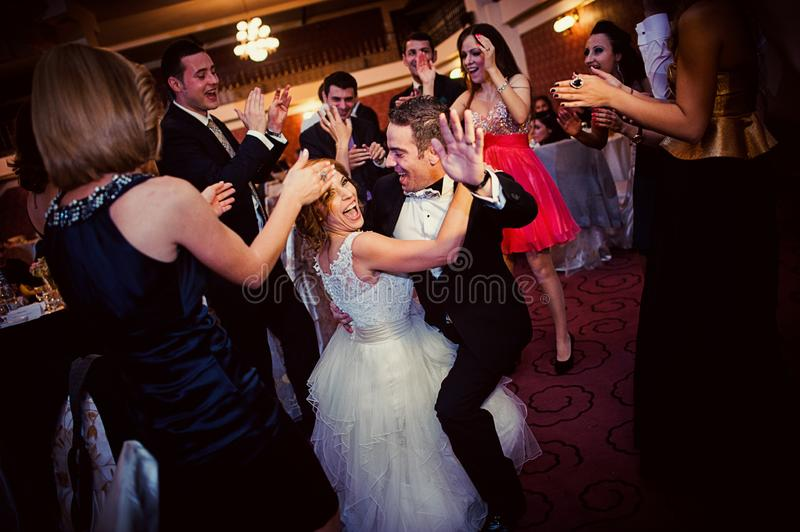 Wedding party dance. Special moment. Bride and groom dancing surrounded by their friends at their wedding party