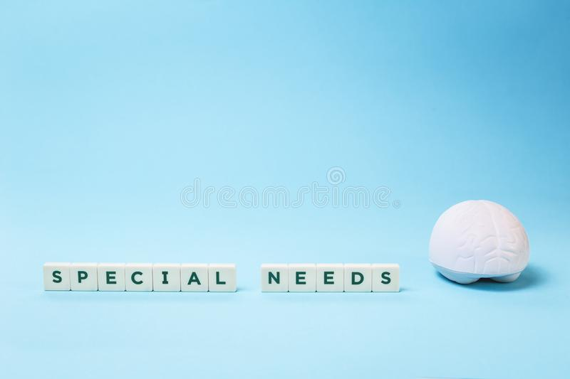 Special needs word with a brain on blue with copy space royalty free stock images