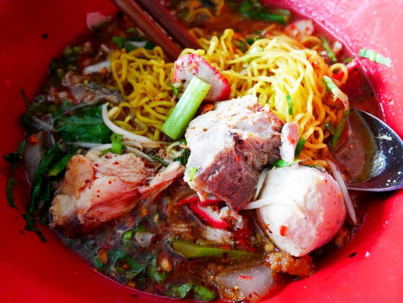 Special noodle spicy soup or noodles tom yum soup thai style with pork and other seasoning on table in local restaurant stock images
