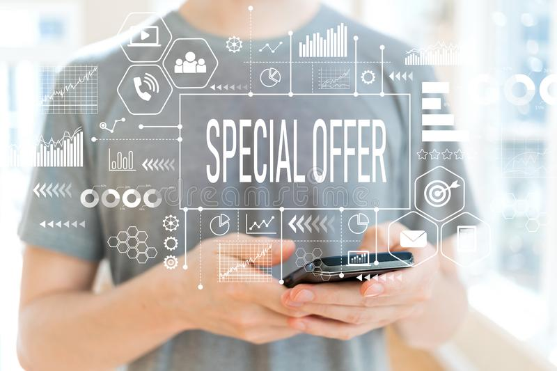 Special offer with man using a smartphone royalty free stock image