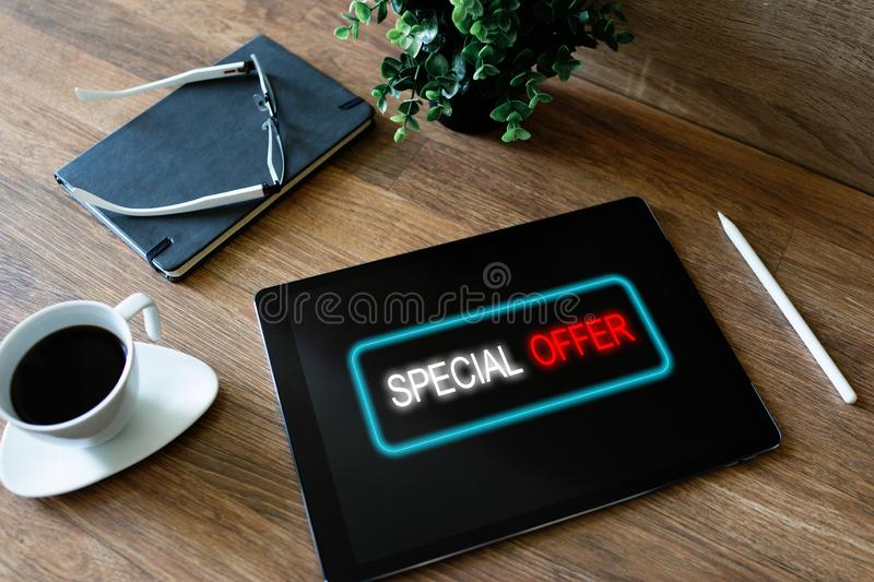 Special offer message on device screen. Sales and marketing, promotion and advertising concept. royalty free stock images