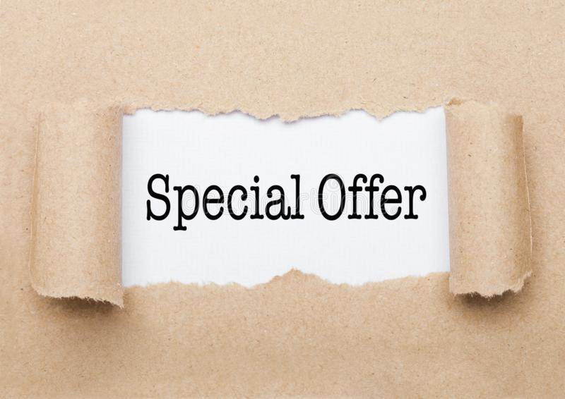Special Offer text appearing behind brown paper royalty free stock photo