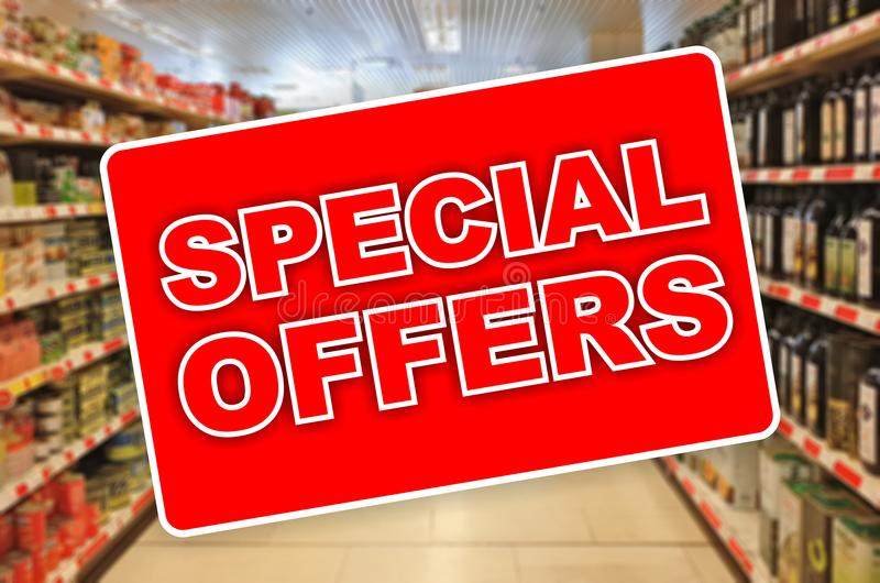 Special offers red label on an abstract Supermarket background. Special offers red label on a blur Supermarket background stock photos