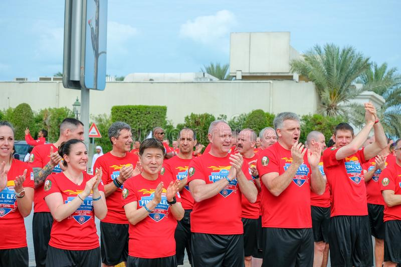 Special Olympic athelets clapping and cheering other athletes royalty free stock image