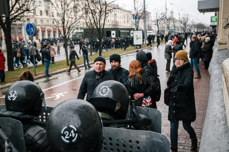 Special police unit with shields against ordinary citizens and protesters in Minsk stock photo