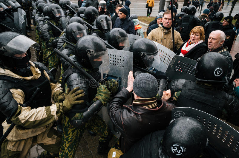 Special police unit with shields against protesters in Minsk stock images