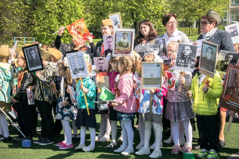 Russia. Moscow, May,07.18: Special public kindergarten action `Immortal regiment`, military state propaganda for russian kids. Special procession of the stock photography