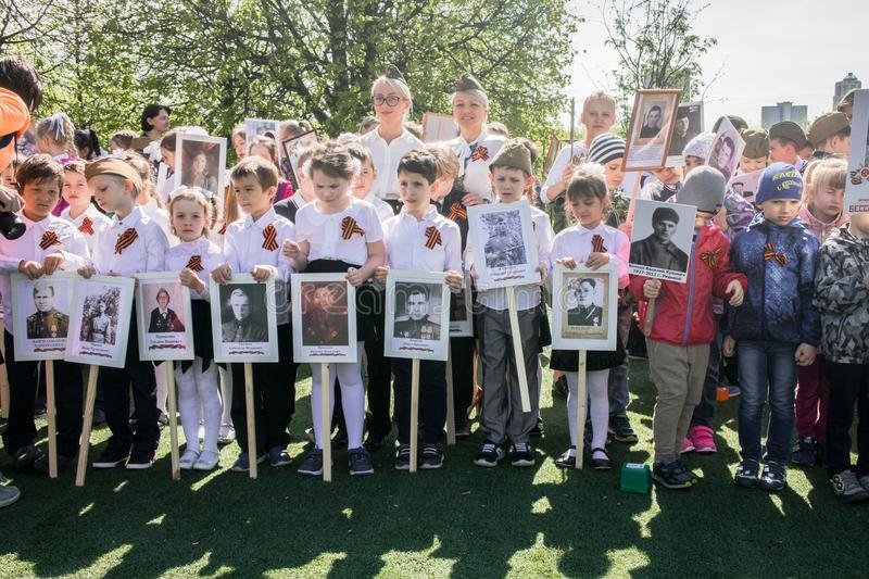 Russia. Moscow, May,07.18: Special public kindergarten action `Immortal regiment`, military state propaganda for russian kids. Special procession of the stock image