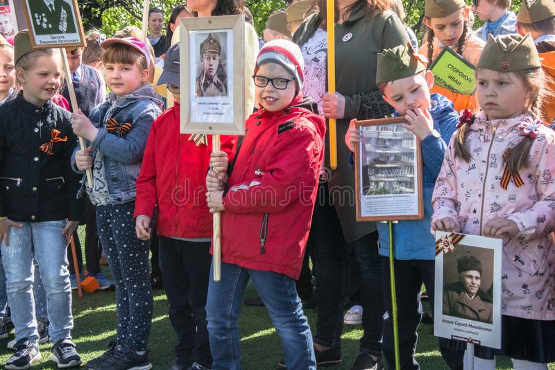 Russia. Moscow, May,07.18: Special public kindergarten action `Immortal regiment`, military state propaganda for russian kids. Special procession of the royalty free stock image