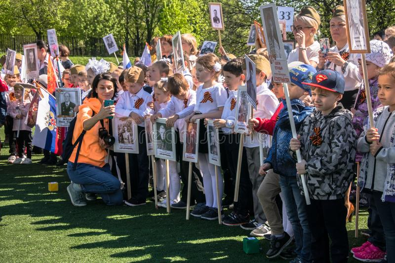 Russia. Moscow, May,07.18: Special public kindergarten action `Immortal regiment`, military state propaganda for russian kids. Special procession of the royalty free stock photo