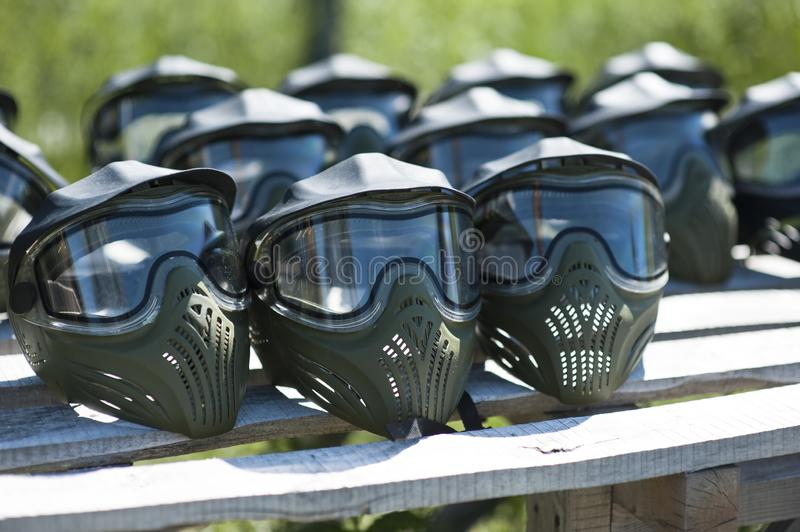 Special protective mask for playing paintball with traces and spot of hit of a ball with paint. Equipment for playing paintball on stock images