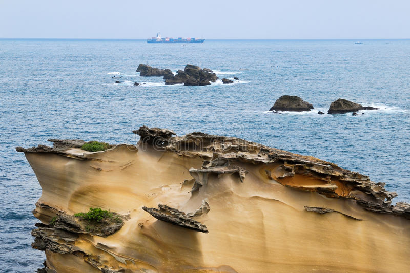 Special rocky coast with a ship. On the ocean royalty free stock image