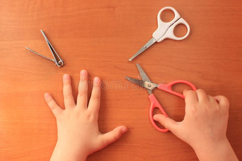 Hand and nail care for the child. Children`s manicure. View from above. royalty free stock image