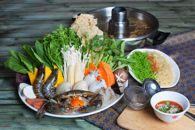 Special seafood hot pot with shrimp, crabs, vegetables, clams an royalty free stock photography