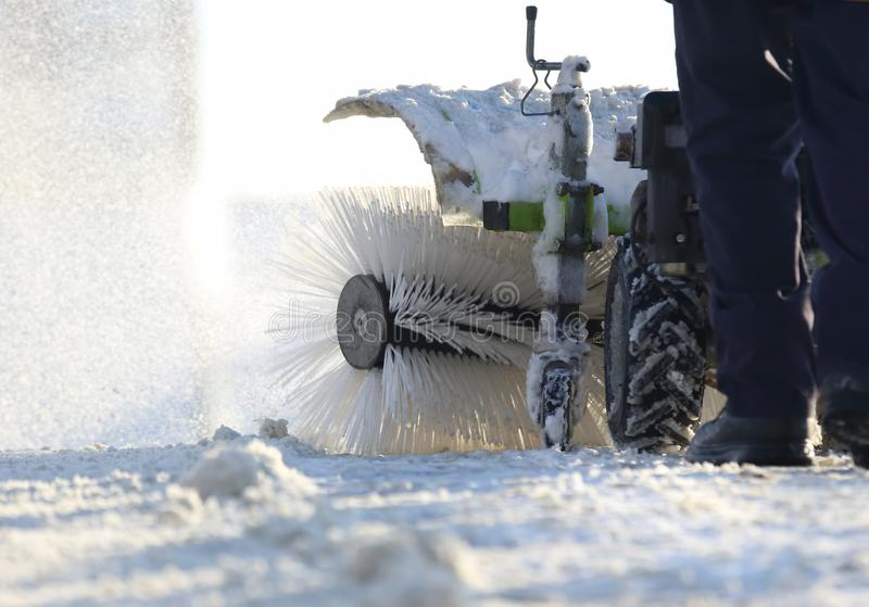 Special snow machine clears snow on the city street. The Special snow machine clears snow on the city street stock photos