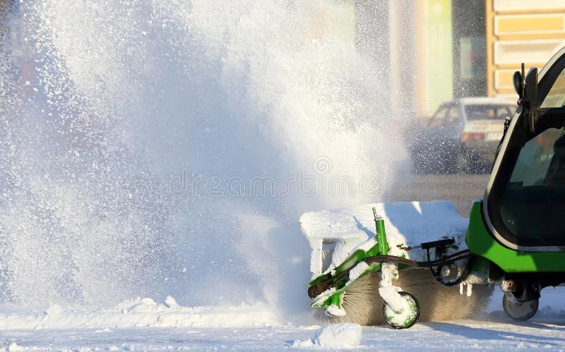 Special snow machine clears snow on the city street. The Special snow machine clears snow on the city street stock photo