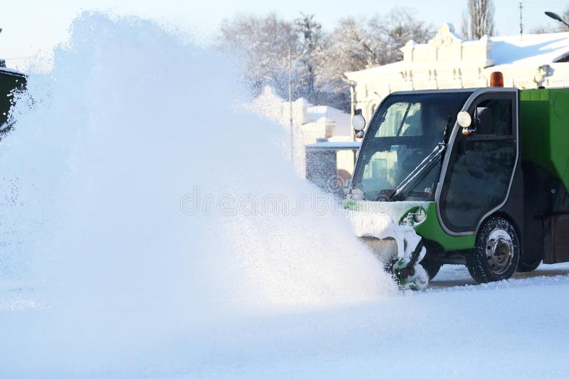 Special snow machine clears snow on the city street. The Special snow machine clears snow on the city street stock photography