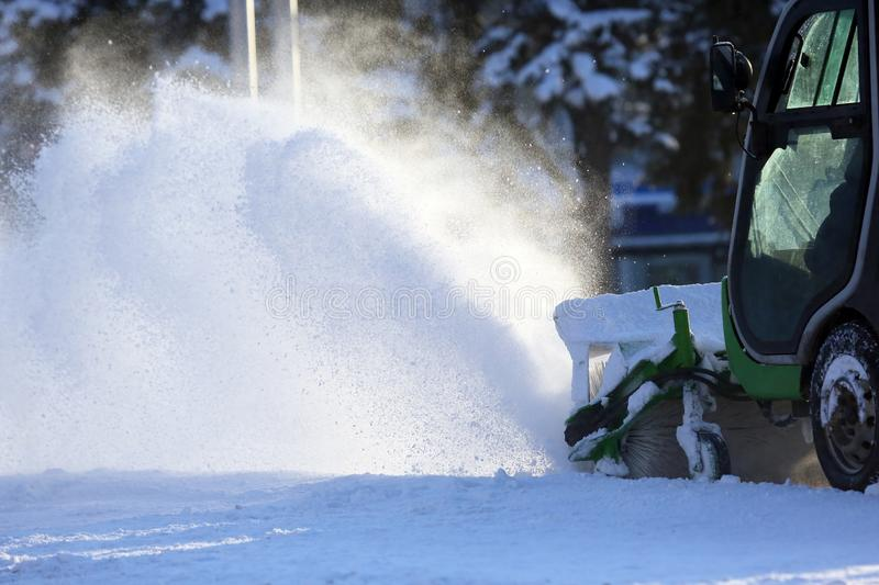Special snow machine clears snow on the city street. The Special snow machine clears snow on the city street royalty free stock photo