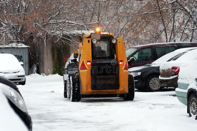 Special snow removal equipment left for snow removal in winter. Heavy snowfall in the city, people can not cope.  royalty free stock photos