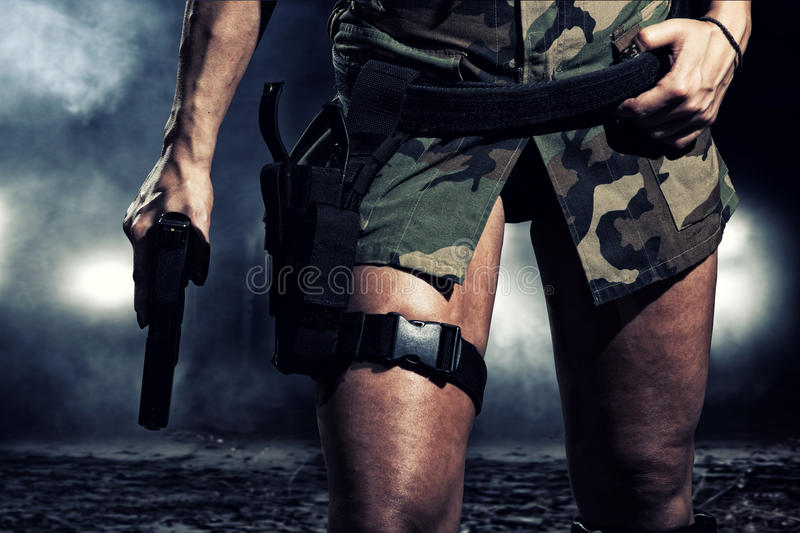 Special tactics woman. Holding up her weapon stock images