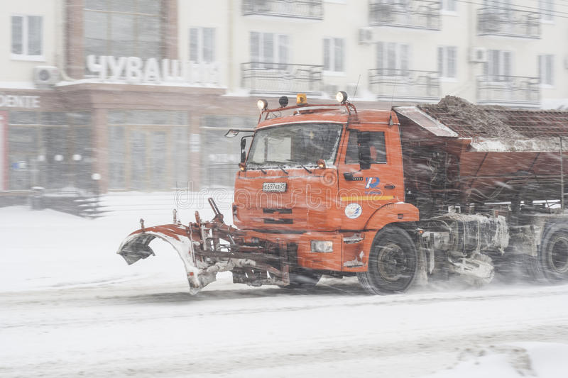 Special technique removes the snow from the street during a snow storm in poor visibility. Snow storm in the city of Cheboksary. Chuvash Republic, Russia stock photo