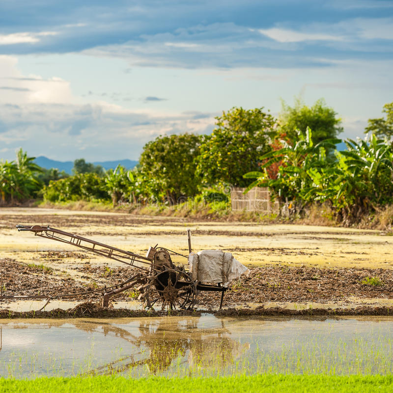 Special tractor to prepare the seedbed for Rice fields with blue. Special tractor to prepare the seedbed for Rice fields in the north of Thailand stock photos