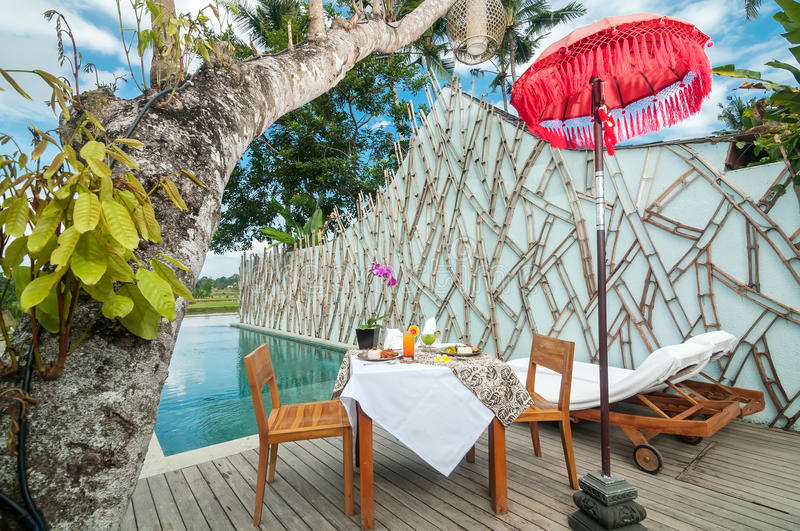 Special traditional lunch menu set on the table outdoor. Special lunch set on the table outdoor with Indonesian traditional food, pool area, overlooking to the royalty free stock photography
