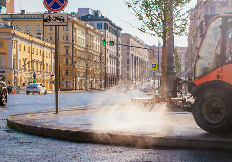 Special truck for city cleaning. Summer, dawn. Early morning in Moscow royalty free stock photo
