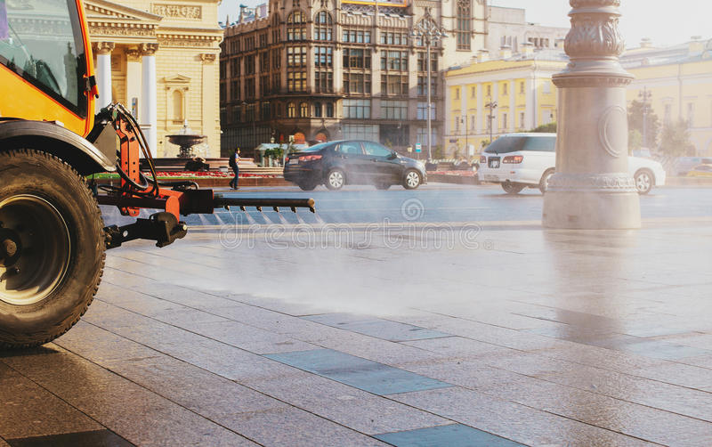 Special truck for city cleaning. Summer, dawn. Early morning in Moscow stock images