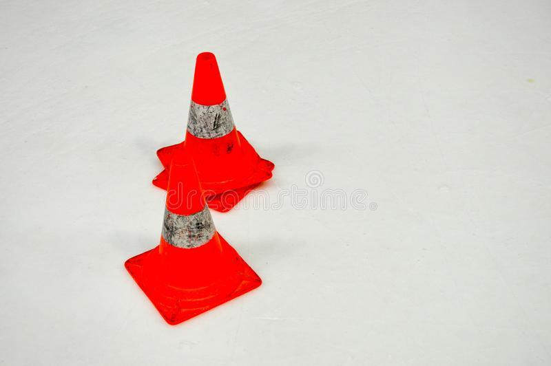 Special warning damaging plastic orange cones on white ice on ice hockey. Arena stock photography