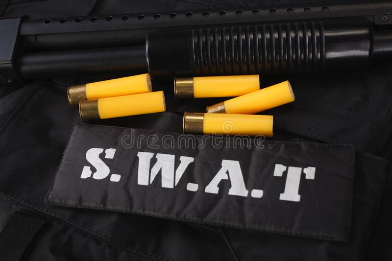 Special weapons and tactics team weapon, ammunitions and equipment on black uniform stock photo