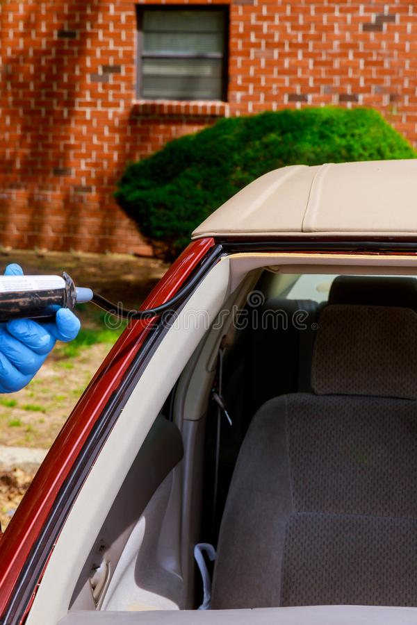Special workers replacing windscreen using silicone tools windscreen crack broken windshield on the front window glass glue stock image