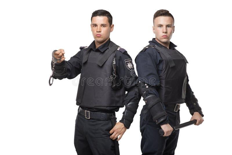 Speciale krachttroepen met een knuppel en handcuffs stock afbeeldingen